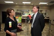 Lourdes Ortiz-Houman, branch manager for the central Tampa office, speaks with Kevin Jones, president and CEO of MidFlorida, at the West Waters branch in Tampa.
