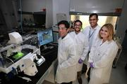 Richard Crouse, biomedical intern, Anil Achyuta, principal investigator and bio engineer, Shankar Sundaram, Tampa director, and Amy Conway, bio engineer, in the cell culture lab at Draper Laboratory on the USF campus.