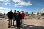Robert Ledford II, principal with Baker Barrios Architects, Ron McDaniel, project manager with ZMG Construction Inc, Roxanne Amoroso, senior VP for Bank of America Community Development Corp., Mark Shafer, owner of PaverSmart.Biz, LLC and Marc Mariano, assistant director of site development with Cardno TBE on the 40-acre site with downtown Tampa behind them.