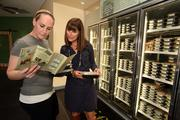 Lizzy Shearn, wellness coach of the Clearwater store, helps customer, Caras Brundage, from Safety Harbor, buy prepared meals.