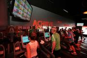 Each person wears a heart rate monitor and can see their progress on a screen, which tells them their total calories burned and amount of time spent in each zone. At Orangetheory Fitness studio on S. Dale Mabry.