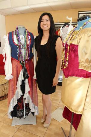 Quynh Le owns Dorcas' Dressmaking and Alterations in Tampa. Gasparilla Krewe members are spending more this year on tailored costumes.