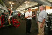 Johnny Sanguinetti, co-owner of Powerhouse, speaks with Stoltenberg in the gym.