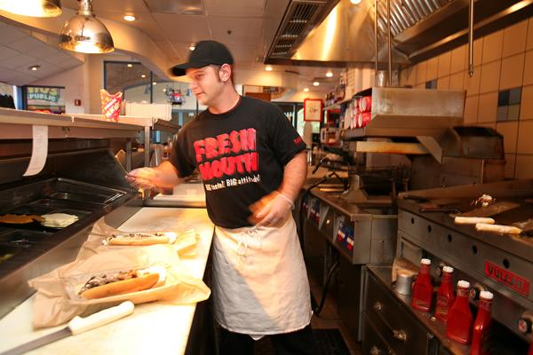 """Fresh Mouth cook Jamie Kaitanowski at work. Restaurant owner Joe Vigliarolo said Guavaween brings in a """"tremendous influx"""" to his concepts he has """"staffed up"""" for the occasion."""