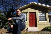 Nathan Bangs, Keller Williams South Tampa Realtor, at a listed home in South Tampa that's abandoned. The home was recently broken into and appliances stolen.