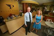 Roy Hellwege, CEO of Pilot Bank, and Lorrie Jackson, business development officer in the Westchase branch.