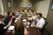 MedPartners employees listen to speaker Leslie Humphrey during their healthy living workshop.