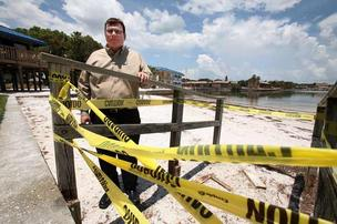 Steve Springman, general manager of Magnuson Hotel-Marina Cove in St. Petersburg, on the beach with one of the stairs on the property that was destoyed by Tropical Storm Debby.