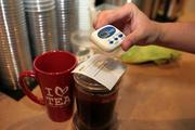 Kim Pham, founder of Kaleisia Tea Lounge and tea specialist, making tea for customers.