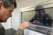 Dr. William Dalton, CEO of M2Gen, stands in front of Nexus Biostore freezers.