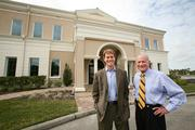 Gar Urette and Michael Urette, father and son partners, with a recently finished office building.