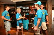 A family from Holland shopping during their day at Busch Gardens. Hans, Maria, Frank and Anthony buy hats and drink cups.