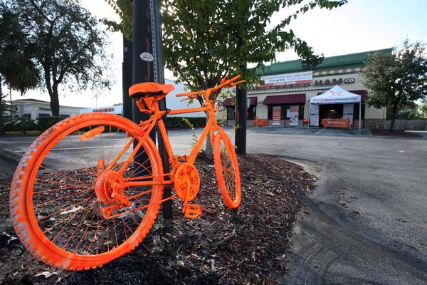 Orange-painted bikes near Dale Mabry and Kennedy Boulevard advertise for Orangetheory Fitness.