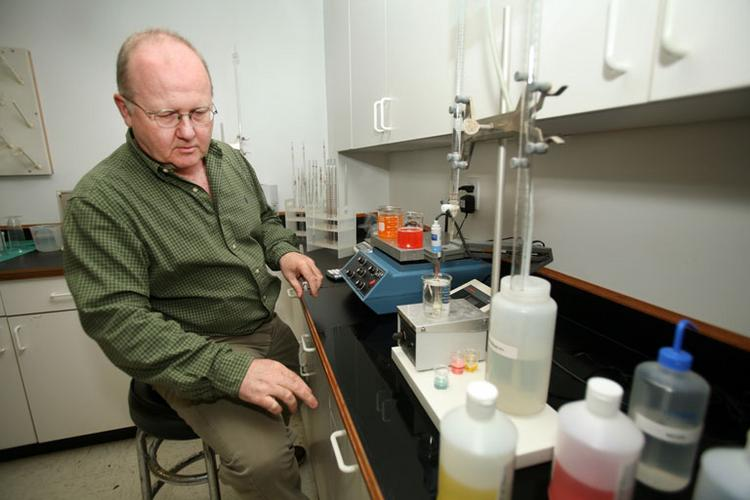 PACA Foods' Bob Cabral, food scientist, in the quality control lab checking the acid level on a beverage mix.