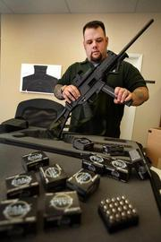 T.J. Sanna, general manager of Liberty Amunition in Clearwater, with Halo-Point Civil Defense .45 ACP ammunition and a Heckler & Koch USC weapon that uses those rounds.