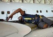 Eugenio Rivera, avionics technician, at work at Pemco World Air Services.