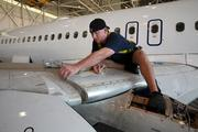 Robert George, aircraft technician, working on an Airbus 320 in the maintenance hanger.