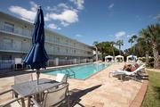 A guest sunbathes poolside at Crowne Plaza Hotel Tampa Westshore.