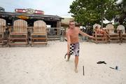 Guest, Jaggar MacDonald from St. Pete, playing horse shoes at Postcard Inn On The Beach at St. Pete Beach.