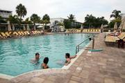 Guests at the pool at Postcard Inn On The Beach at St. Pete Beach.
