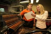 Kathy Ables, press operator, and Casey Corwin, CEO, checking registration on a 2-color print job at Corwin Design & Graphics Corp.