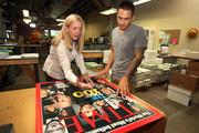 Casey Corwin, CEO, and Alan Garber, graphic designer, discussing the large format specifications on a Time Magazine sample print for an upcoming job.