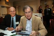 Larry McCabe, Rays senior director of broadcasting, and Irwin Novack, CEO of Kane's.