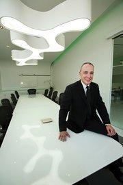 Trevor Burgess is CEO of CBM Florida Holding Company, parent company of Community Bank & Co.