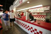 Juanita Hemsley, cashier, waiting on customers during lunch time at Five Guys on West Kennedy.