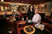 Rick and Sonia Barcena, owners of Rigatoni Restaurant and lounge with some of their signature dishes, chicken marsala, calamari and mussels in red sauce.