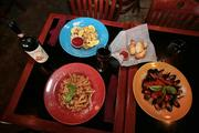 Rigatoni Restaurant and lounge with some of their signature dishes, chicken marsala, calamari and mussels in red sauce.