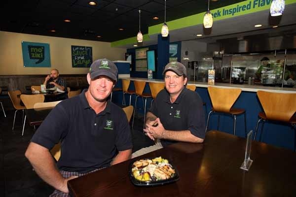 Geoff Brown and Josh Bowles, partners with Mo' Ziki, a Greek-inspired restaurant in Largo