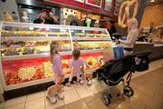 Dunedin resident Rachel Wagoner stops at the Great American Cookie & Pretzel Maker for a snack with daughters Ava, 5, and Audrey, 2, at International Plaza. She had just bought the reindeer for them minutes before. They