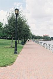 Children play on the Riverwalk path.