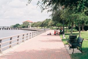 Children play on the Riverwalk path.