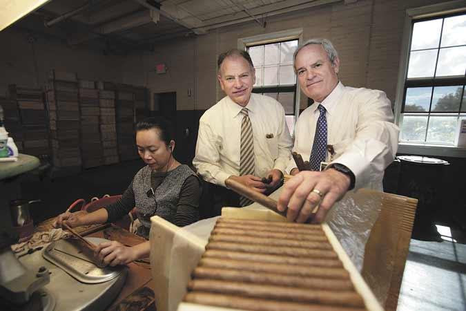 Newman Cigar Co. President Eric Newman, left, and his brother, Bobby Newman, executive vice president at company headquarters in Ybor City.