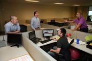 SOE Software Corp's Scott DeMarco, manager IT, Bill Murphy, director of business development, Derek Hughes, enterprise business manager and Phil Krnjeu, S/W developer, in a new client implementation meeting.