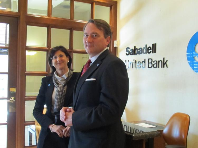 Susan Blackburn, Tampa Bay regional executive for Sabadell, and Dwight Hill, executive vice president