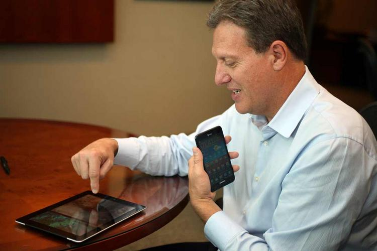 Syniverse Technologies CEO Jeff Gordon uses his iPad and Samsung Galaxy Note in his office.