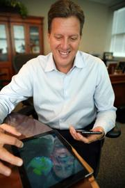 Syniverse Technologies. Jeff Gordon, CEO, uses his iPod and Samsung Galaxy Note in his office.