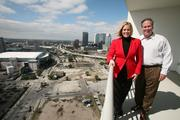 Cheryl McCormick Brown, sales director for The Towers of Channelside, and Steven McAuliffe, broker, on the balcony of the penthouse that still hasn't sold.