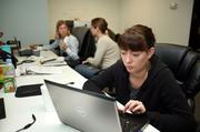 BlueGlass Interactive's Brooke Nichols, director of client development, working in the search marketing department.