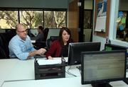 BlueGlass Interactive's Loren Baker, senior vice president of social media and strategies and partner, meets with Andrea Glick, link marketing manager, to discuss link building approaches for a client.
