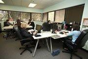 BlueGlass Interactive employees working in the social media marketing war room.