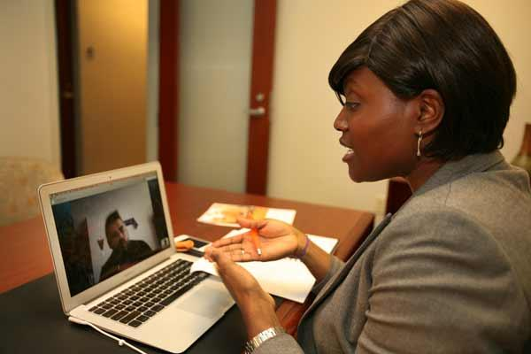 Animus Solutions' CEO Phara McLachlan Skypes with an Animus associate during a business development meeting to discuss signing on a new client in Turkey.
