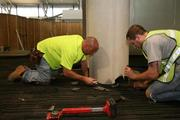 Tampa International Airport's new Airside F for international flights. Joe Dues and Bill Hatley, with Duffy & Lee Carpeting, install carpet in the new queuing area for additional checkpoint space for Airside F.