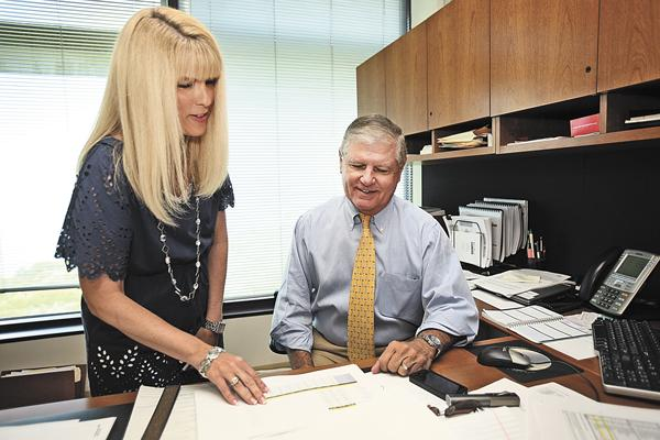 Walter Investment Management's Kim Perez, senior vice president and chief accounting officer, and  Mark O'Brien, chairman and CEO, review new business  opportunities in this July 2011 photo.