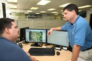 Rapid Systems' Tom Stallings, advance systems engineer, and Dustin Jurman, CEO, review the management system for the Hardee County broadband project.
