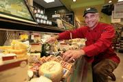 """Whole Foods Market's Kelly Snyder is among only 121 """"Cheese Experts"""" certified by the American Cheese Society. He works at the recently opened Carrollwood location."""