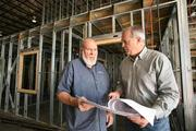 Olive Tree Energy's Tom Hebert, CTO, and Jay Fechtel, president, with the zero energy water heating system. They are at a new facility they are building.